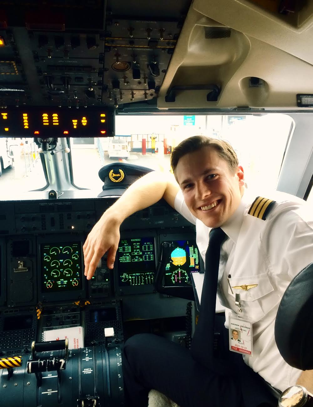 Pilot smiling in cockpit.