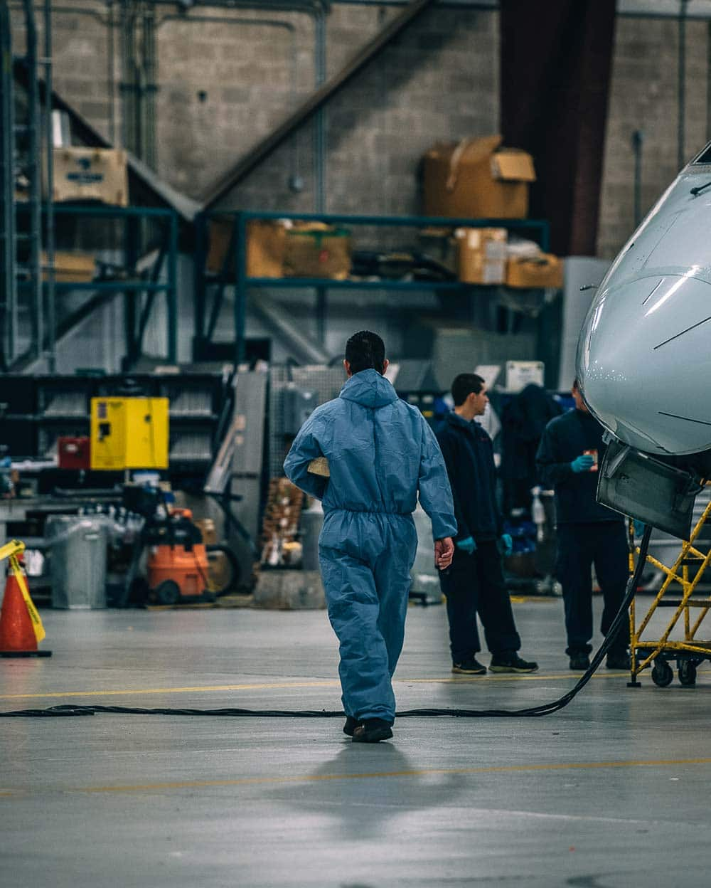 Maintenance crew in hangar.
